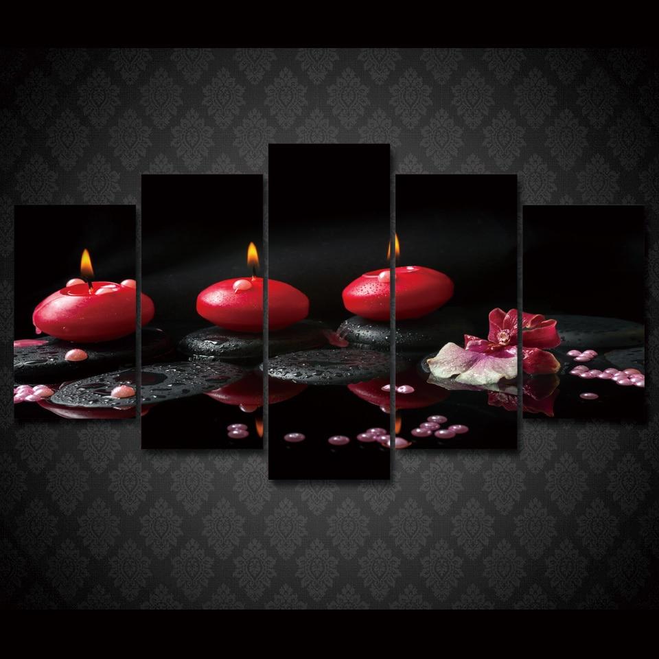 Tableau galets noirs et bougies rouges